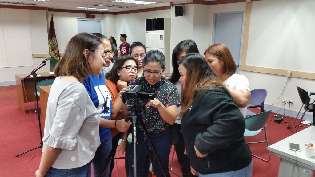 Participants studying the HD Camera during the hands-on session.