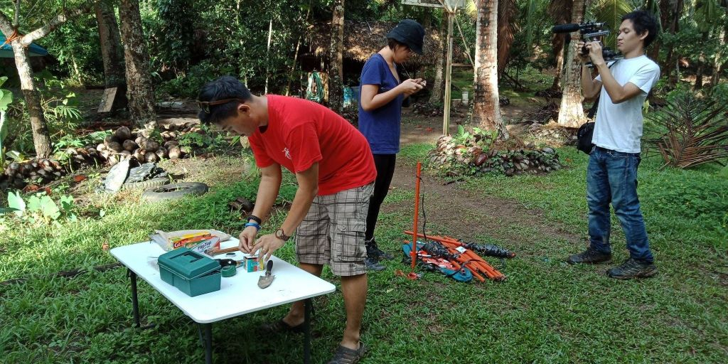 Jabez setting up sampling plots in Quezon with research assistant, Ara Bagunu and documentary filmmaker, Brian Sulicipan (2018). Photo credit: Michael Reyes, Jr.