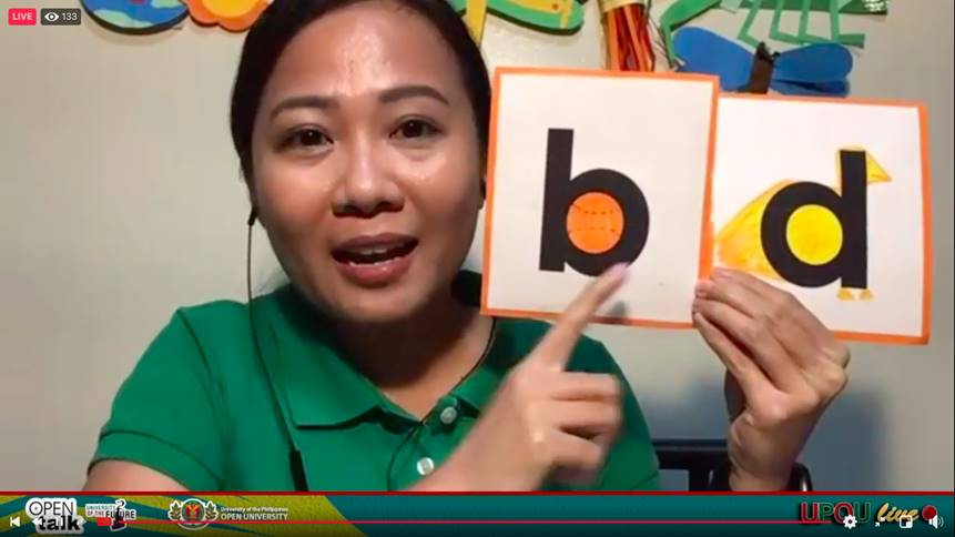 Teacher Michelle with her special alphabet cards.
