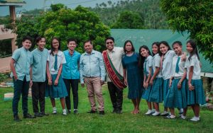 Mr. Bandoquillo with his BKD Officers and parents in Taysan Resettlement Integrated School during his UPOU Virtual Graduation. He insisted on sharing his graduation moment with his students to inspire them to always acknowledge their parents' efforts in achieving one's success.